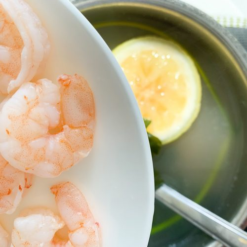 Poached Shrimp in lemon water with parsley and spices