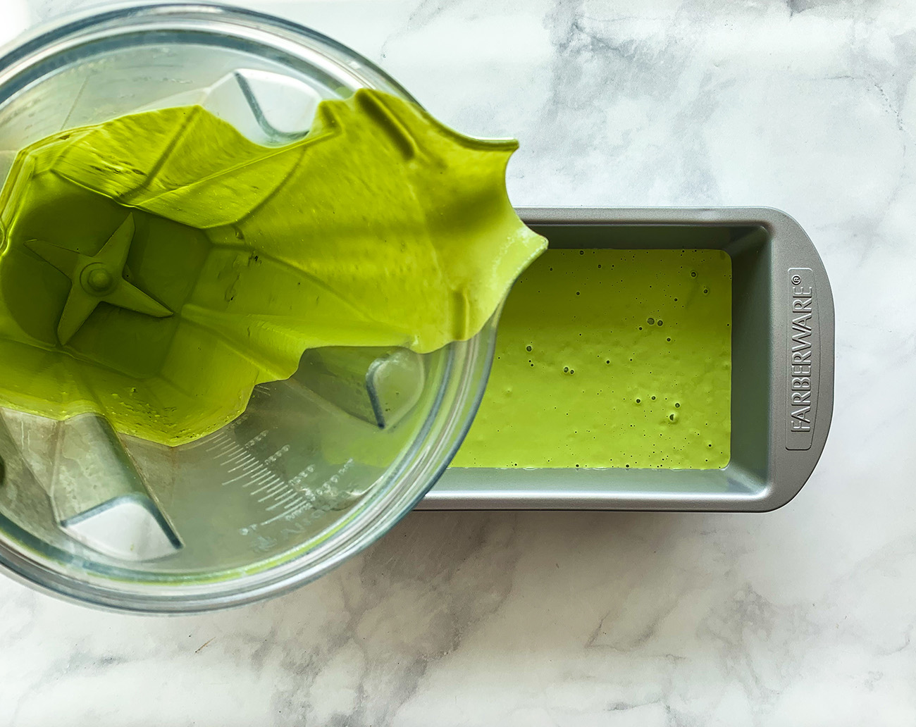 Pouring Matcha Ice Cream into loaf pan