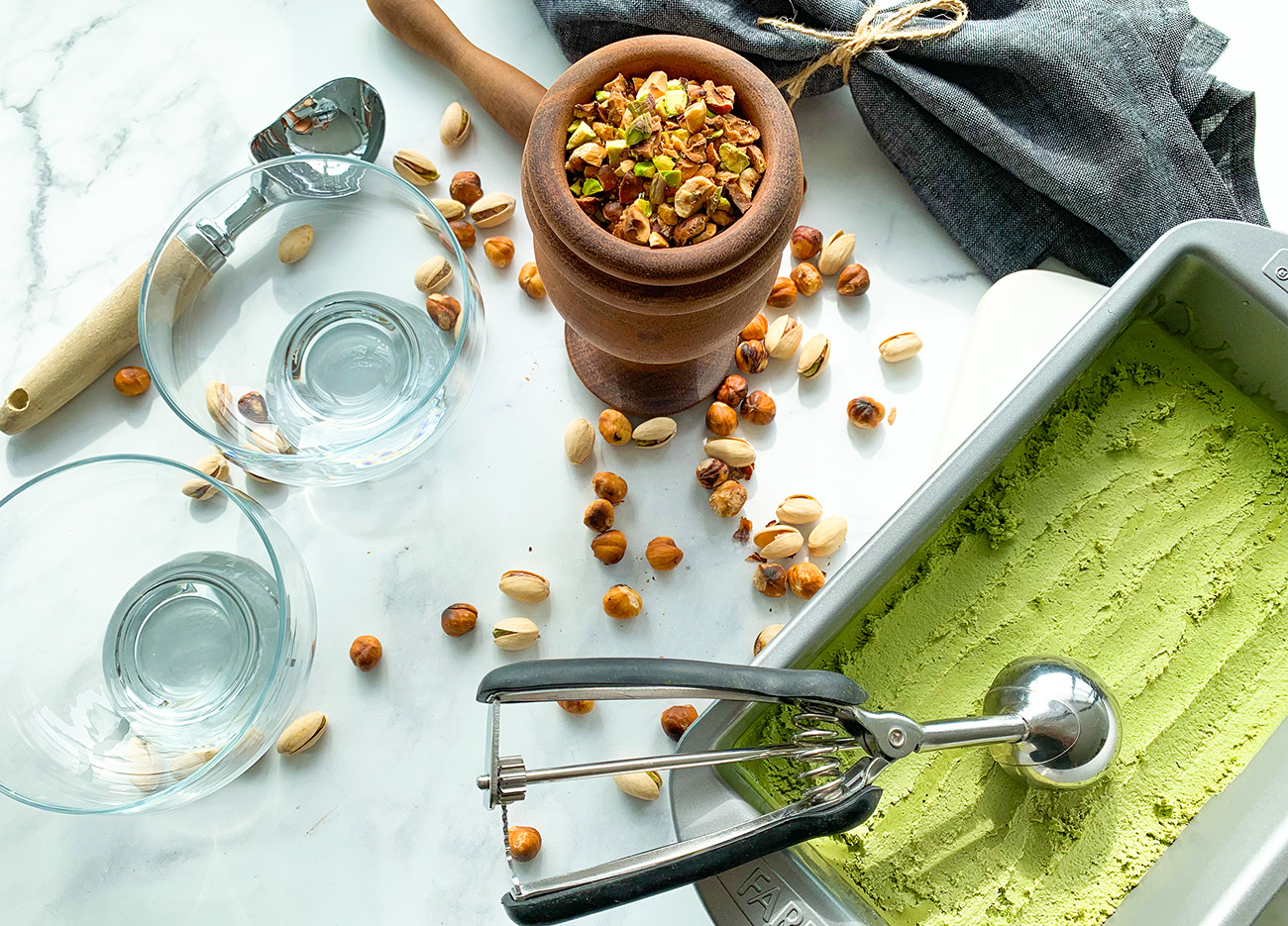 Dairy-free Matcha Ice Cream tub and toasted nuts