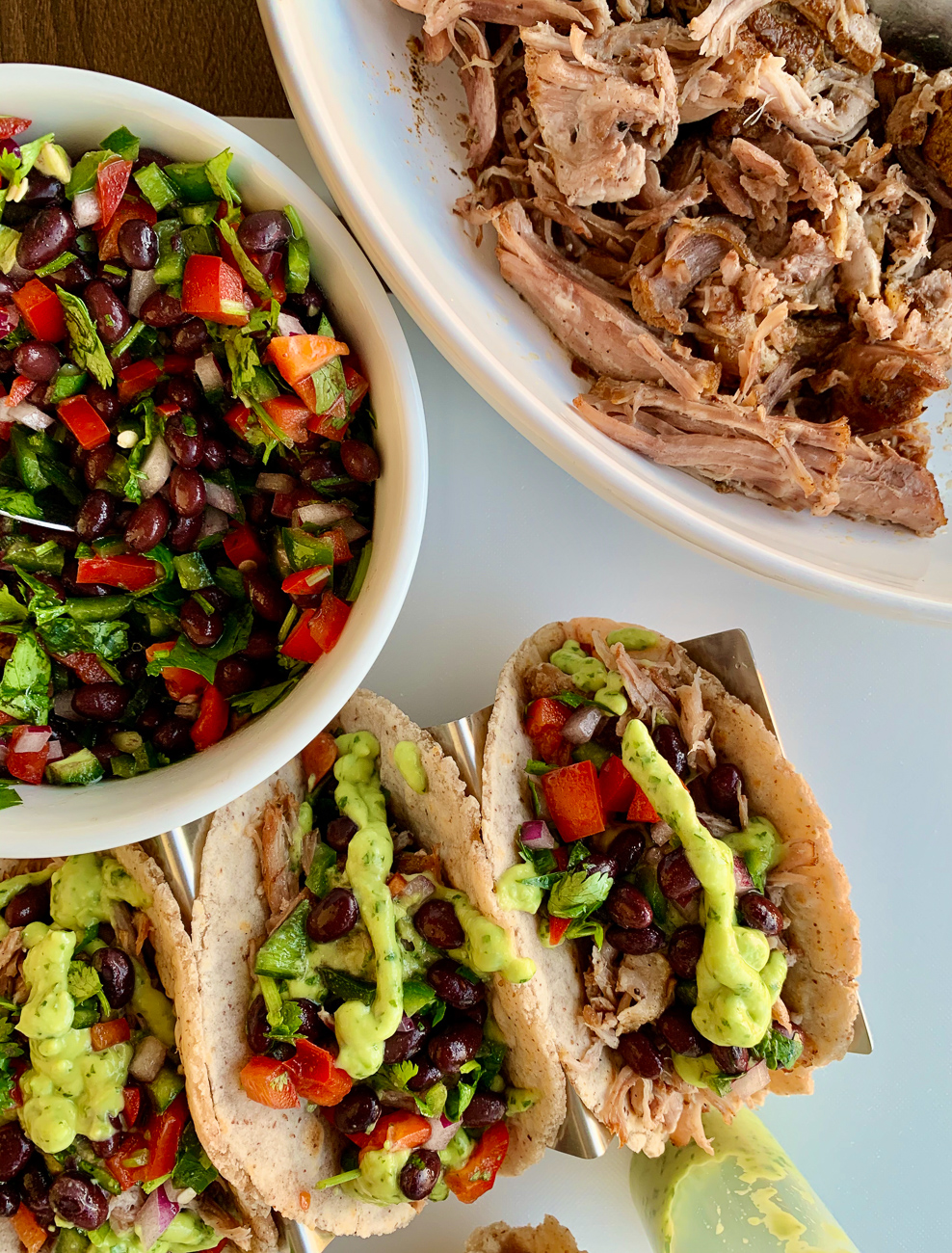 TACOS with pork carnitas and black bean salad