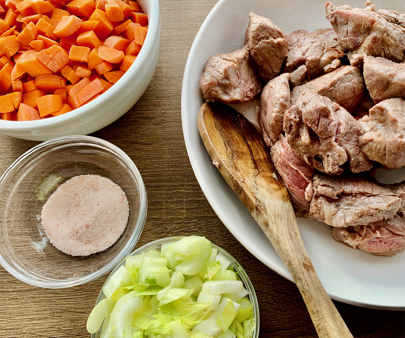Browned Beef and bowls of ingredients for Instant Pot Beef Stew. Full Paleo recipe