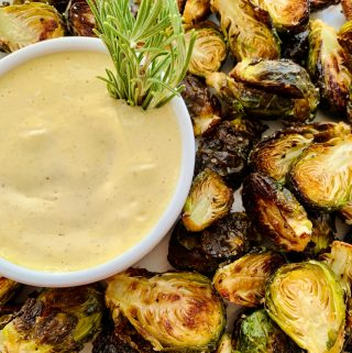 Platter of Roasted Brussels Sprouts with little bowl of bayleaf aioli