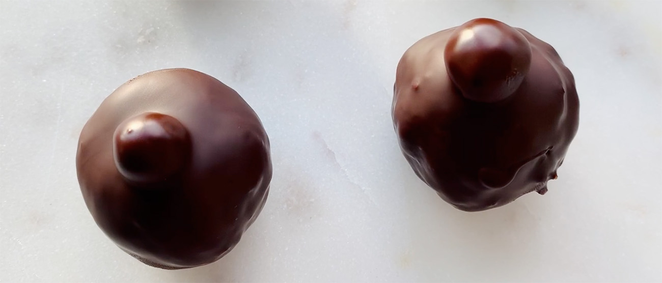 2 Healthy Chocolate Truffles on a marble board