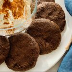 Platter with double chocolate sunflower cookies and bowl of yogurt