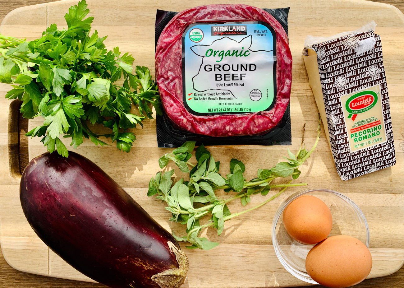 INGREDIENTS FOR MEATBALLS WITH ROASTED EGGPLANT, eggplant, organic ground beef, pecorino romano cheese, eggs, fresh parsley, oregano