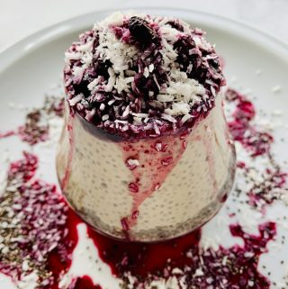 Chia Sunbutter Pudding topped with shredded coconut and blueberry compote
