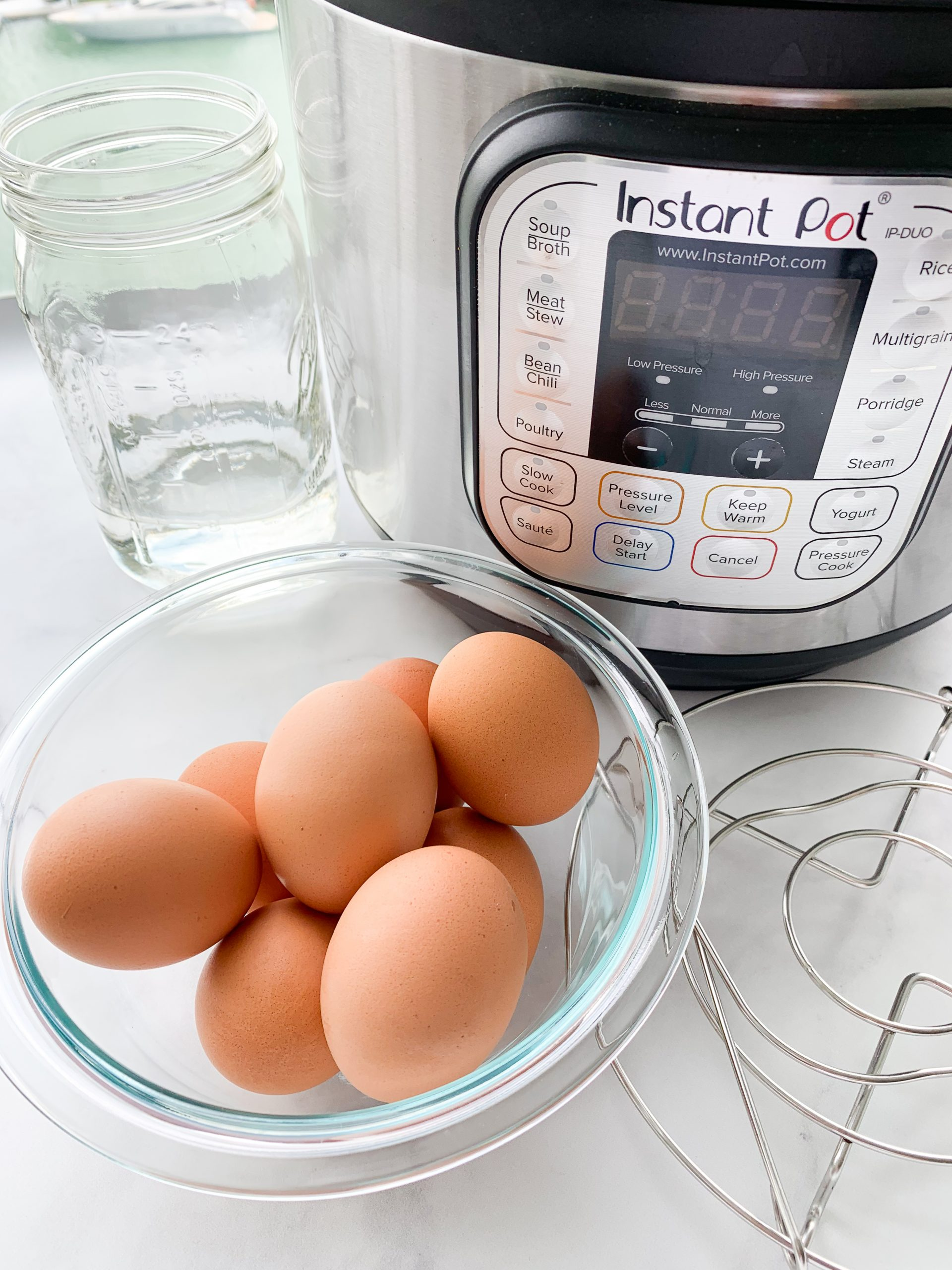 Hard Boiled Eggs in a glass bowl and Instant Pot